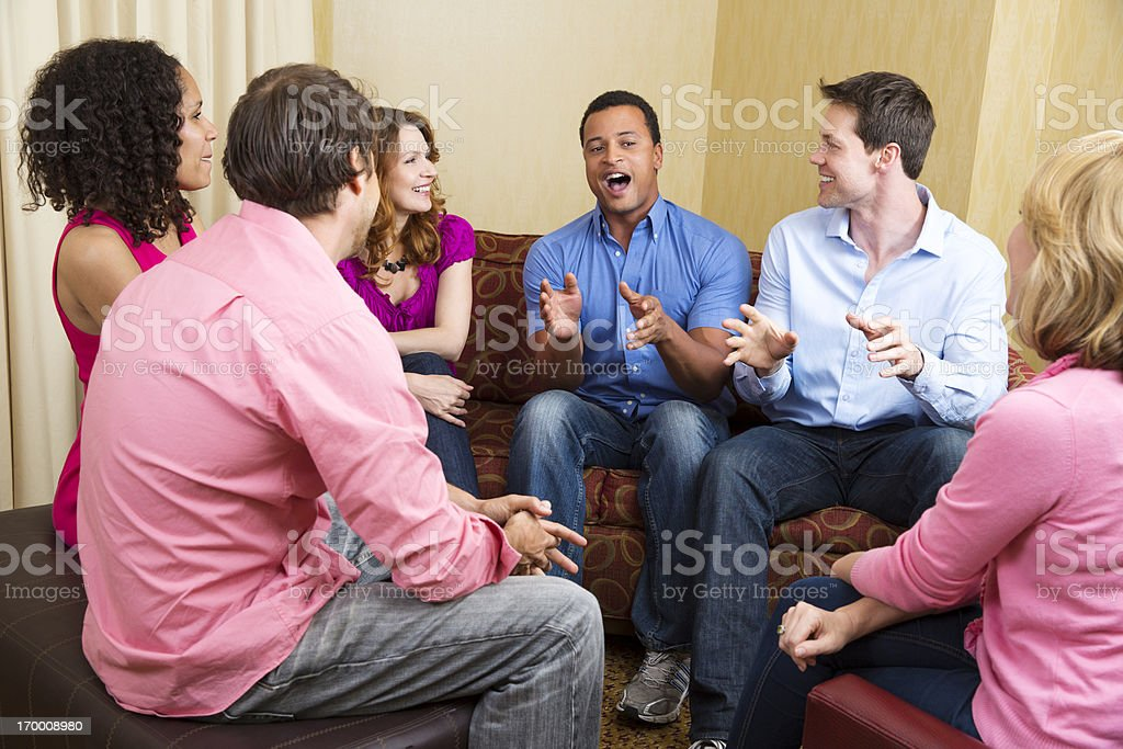 Group of adults passionately talking about something stock photo