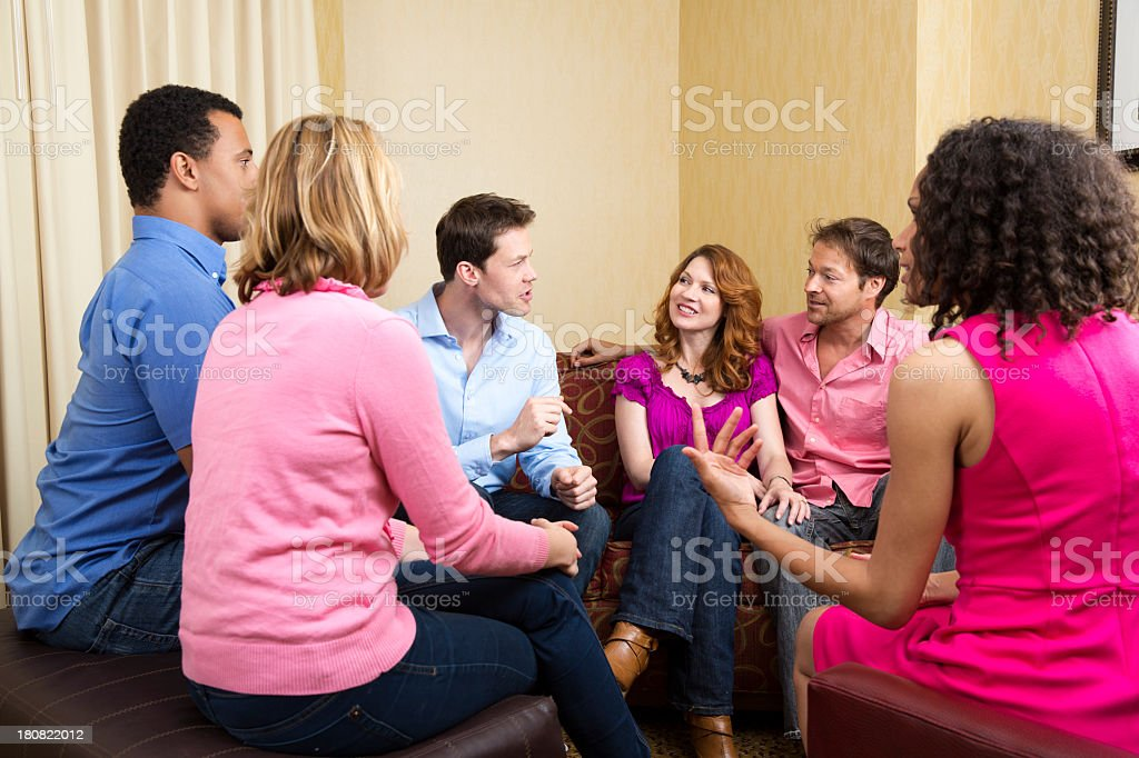 Group of adults talking on the couch royalty-free stock photo