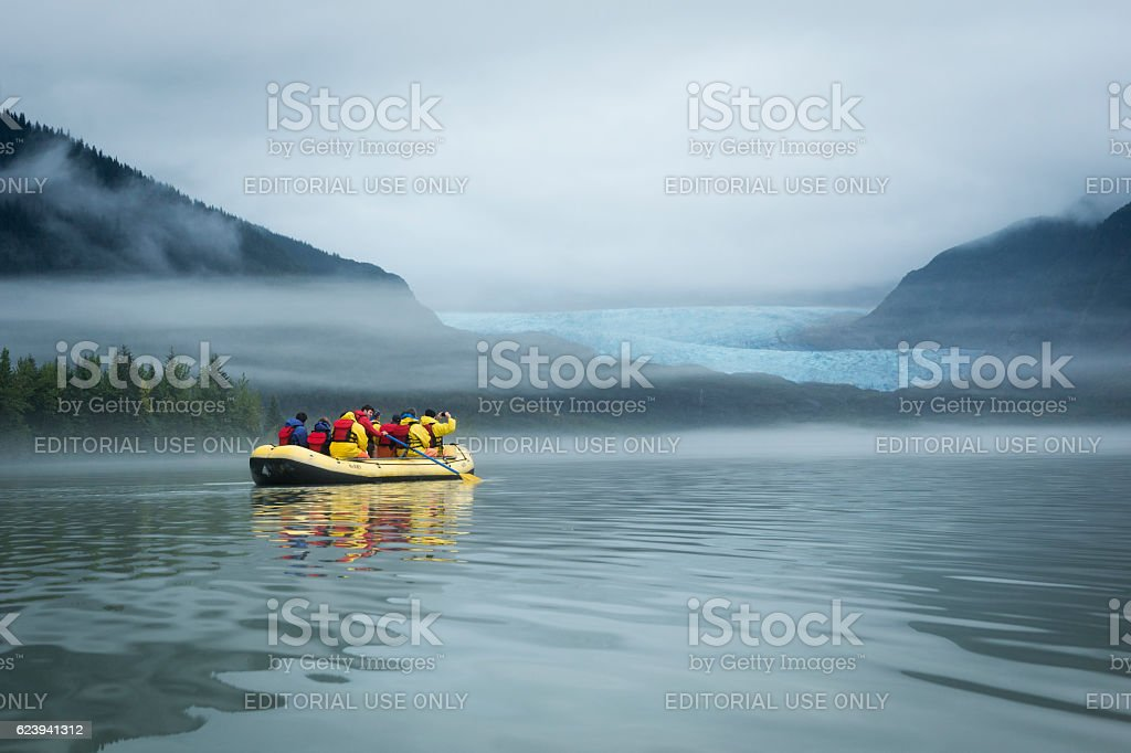 Group of adventurers on Mendenhall Lake stock photo