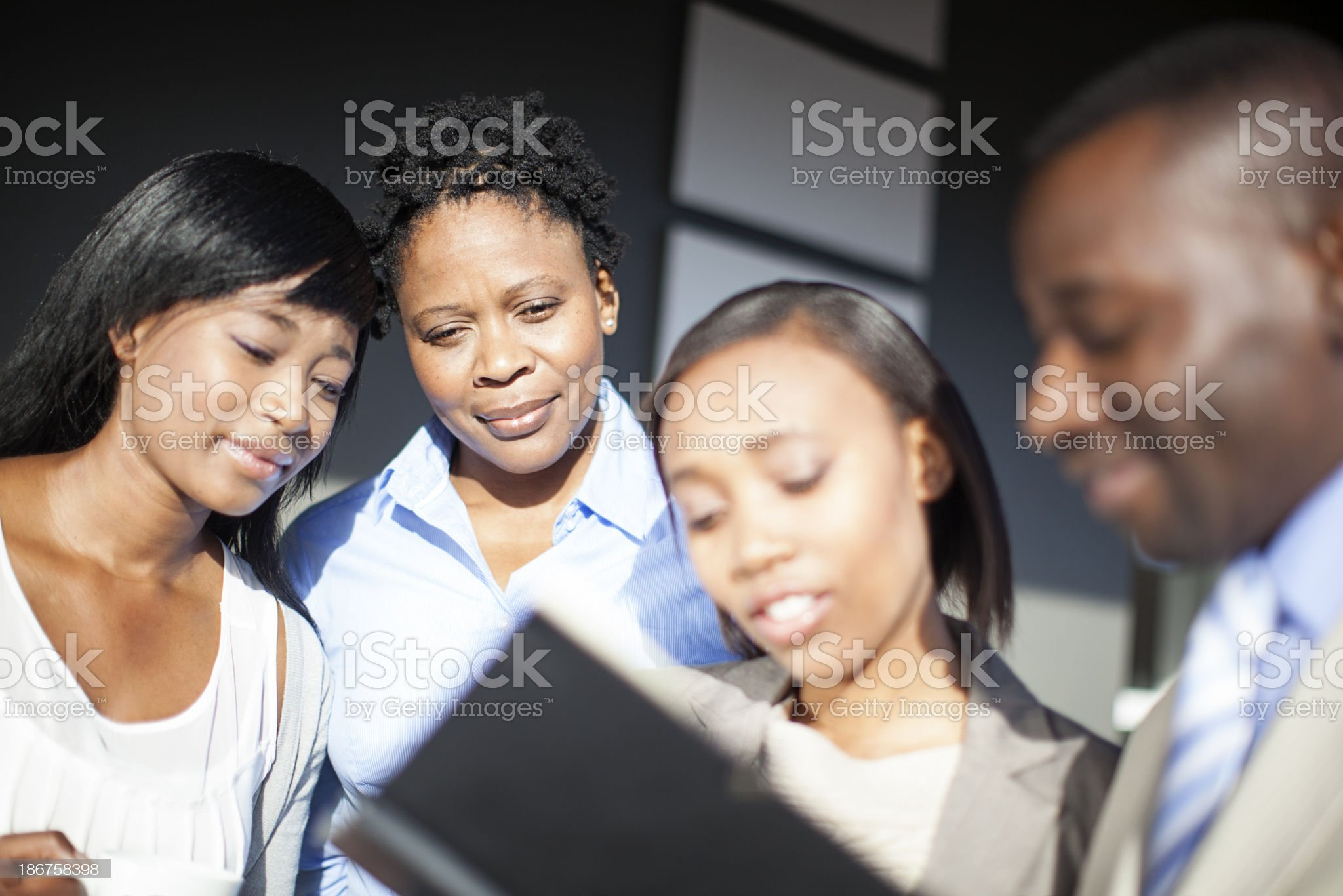 Group of african business people reviewing documents royalty-free stock photo