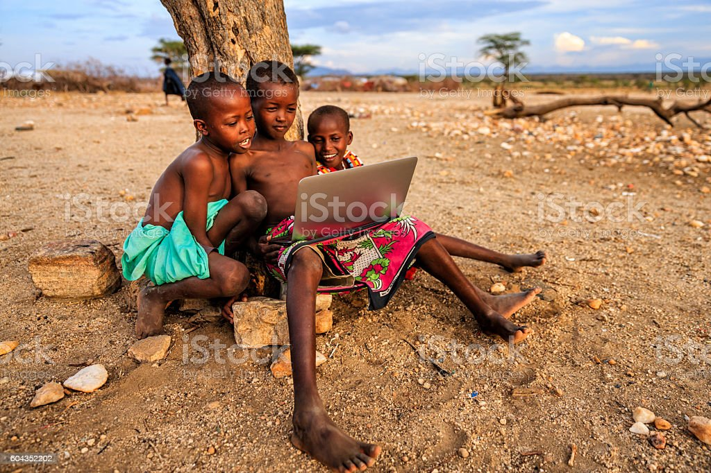 Group of African children using laptop, Kenya, East Africa stock photo