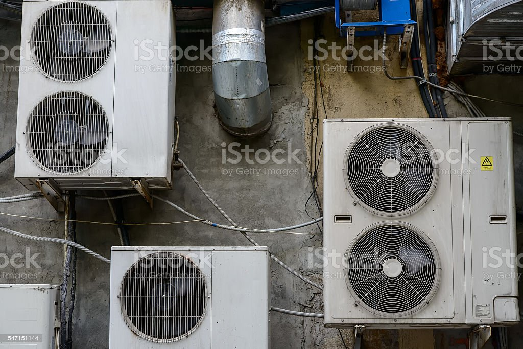 Group of air conditioner units outside building stock photo