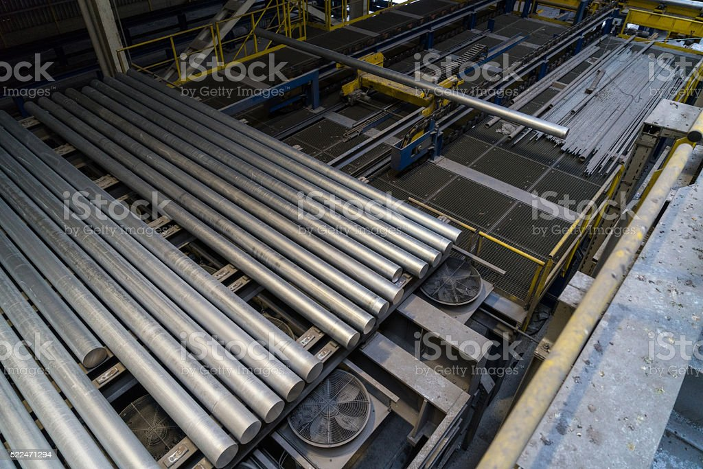 Group of aluminium pipes in mill stock photo