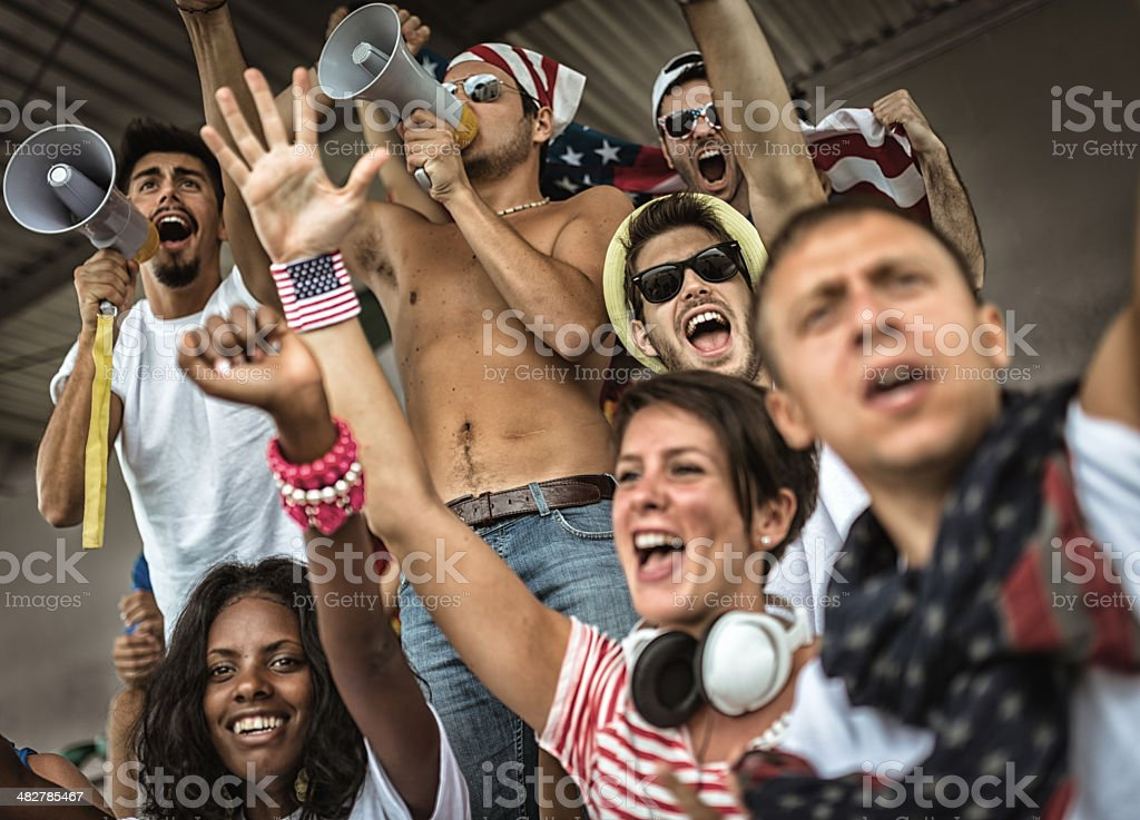 Group of american supporters at stadium royalty-free stock photo