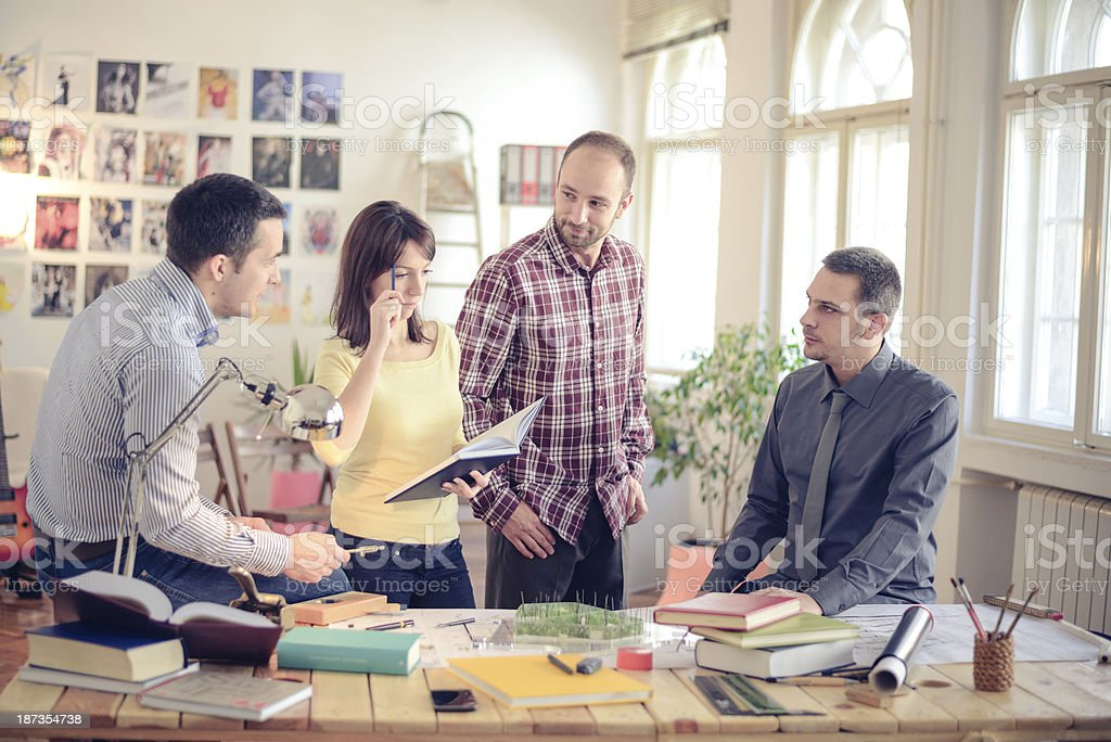 Group of architects discussing in an office stock photo