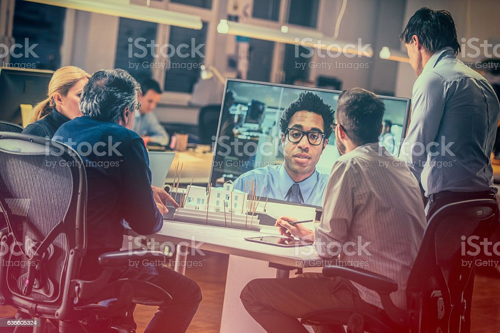 Group of architects having a video conference stock photo