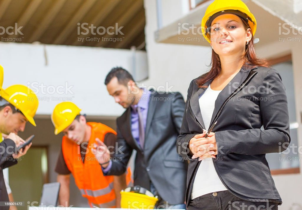 Group of architects looking at the blueprints and plans. royalty-free stock photo