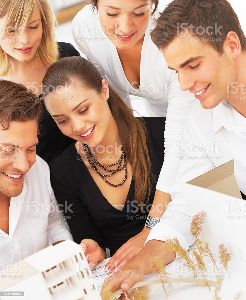 Group of architects planning together royalty-free stock photo