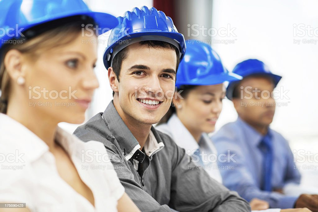 Group of architects wearing hardhats. royalty-free stock photo