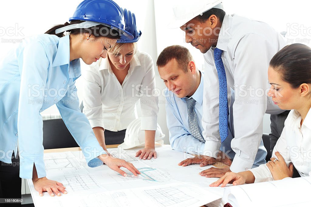 Group of architects working on a blueprints and plans. royalty-free stock photo