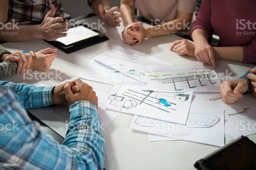 Group of Architects Working on a Plan stock photo