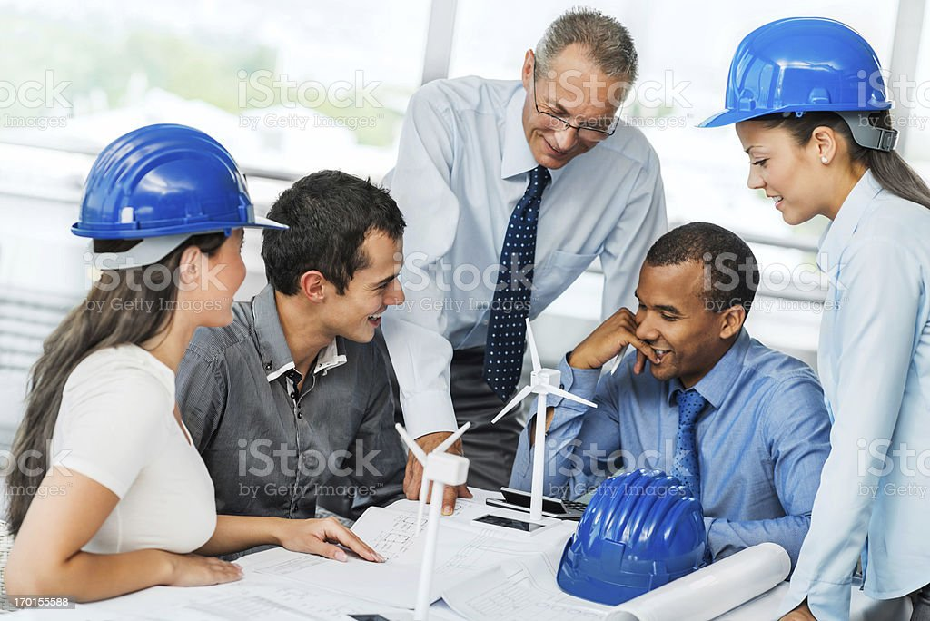 Group of architects working on a Wind Turbine project. royalty-free stock photo