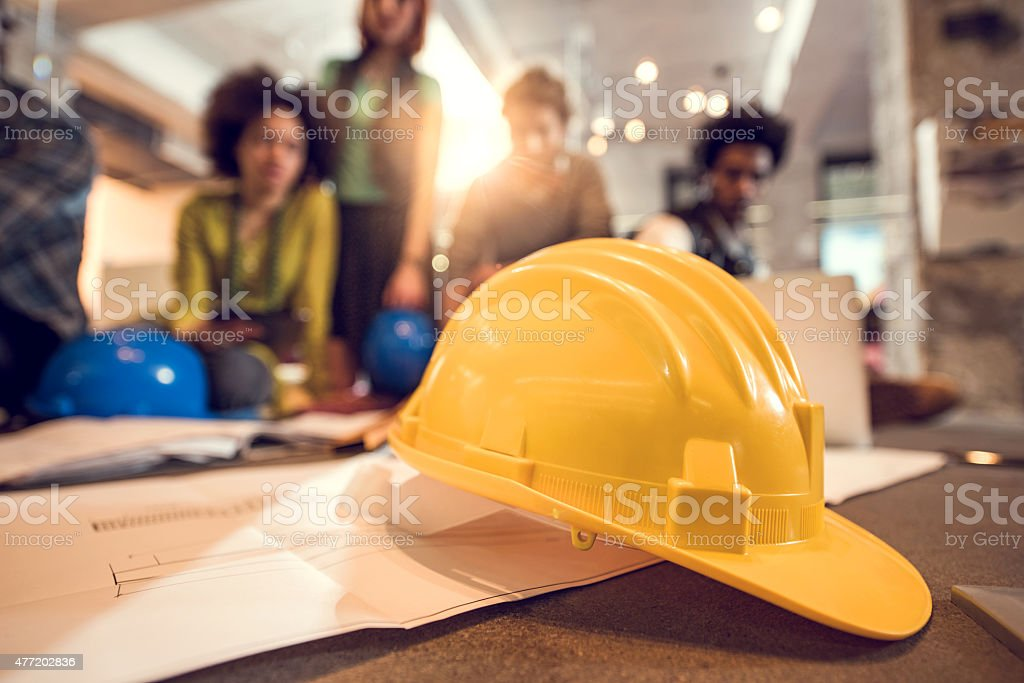 Group of architectural objects with people in background. stock photo