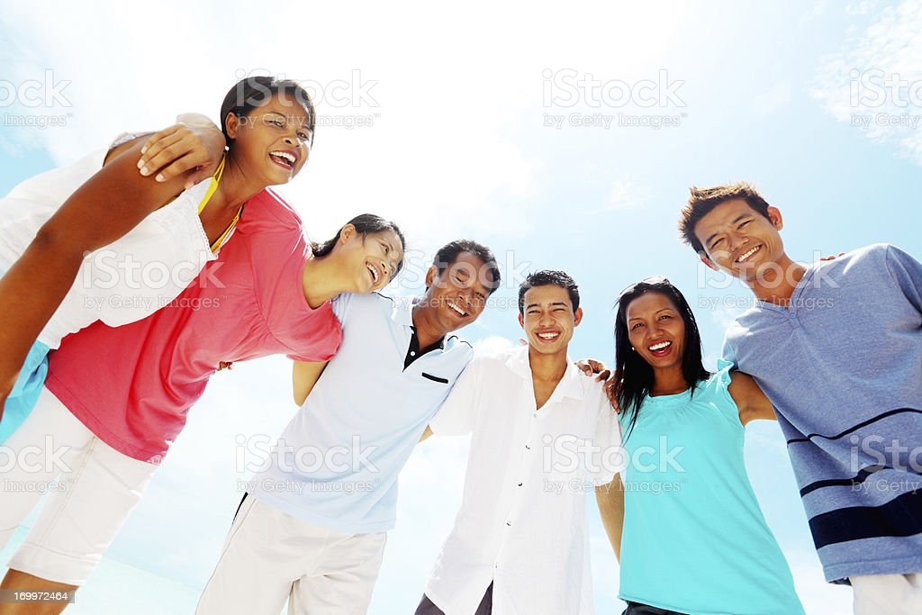 Group of Asian people standing against the blue sky. royalty-free stock photo