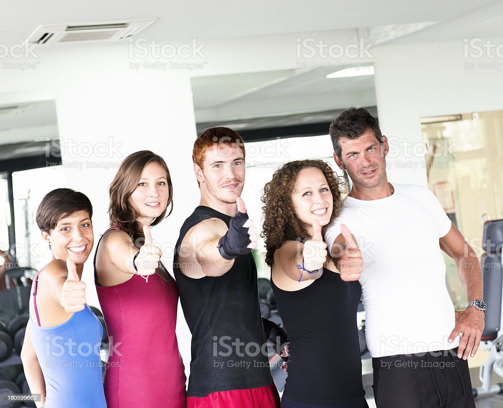 Group of athlete thumbs up on a gym royalty-free stock photo