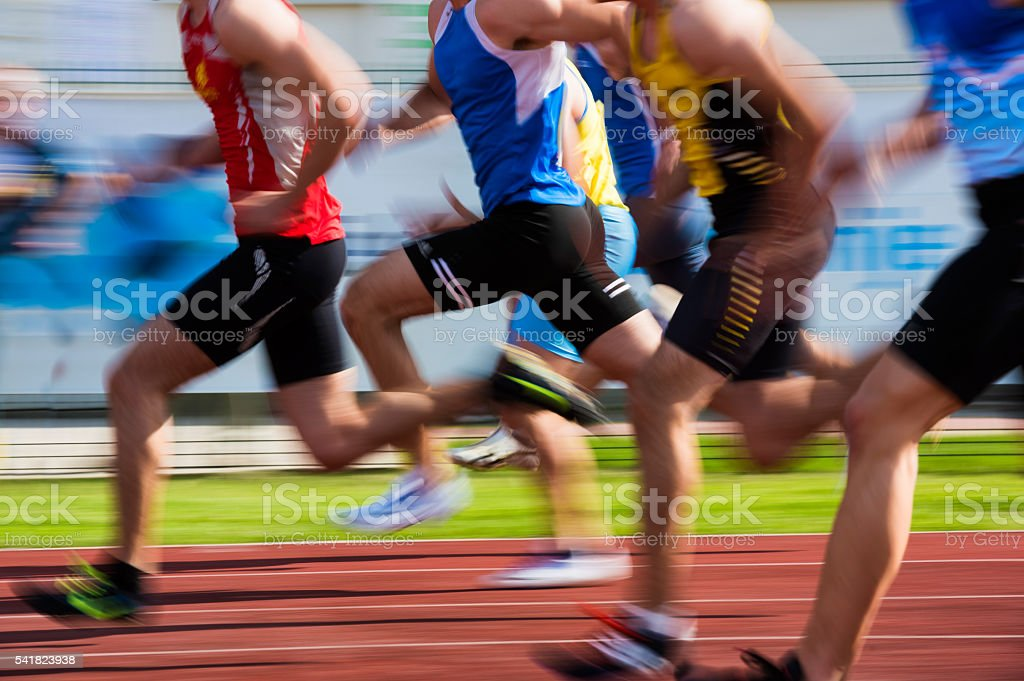 Group of athletes at 100m sprint stock photo