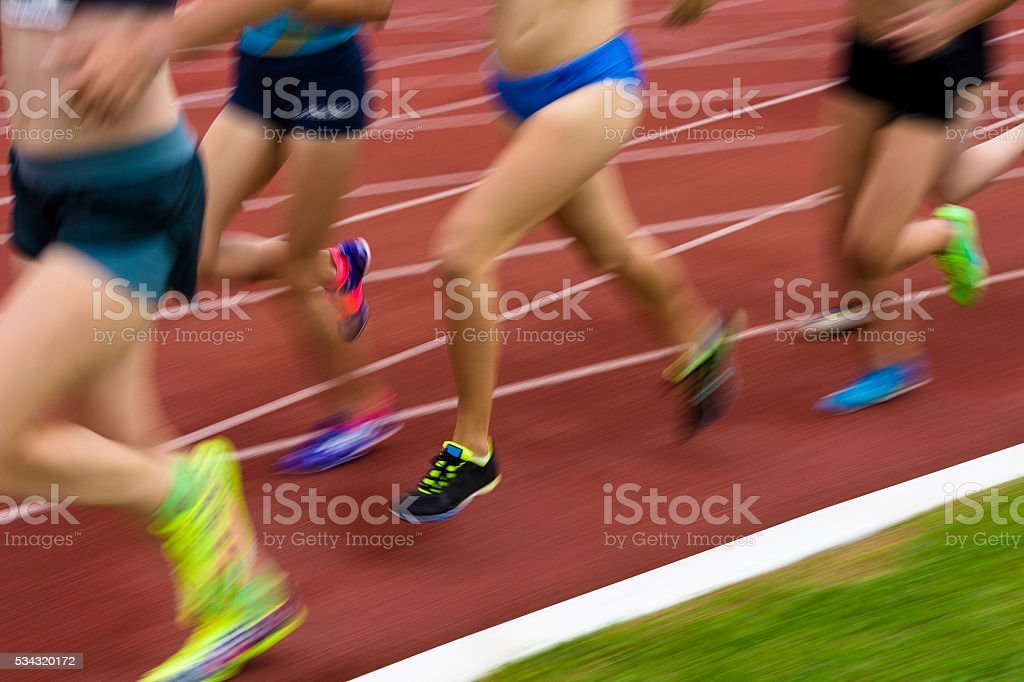 Group of Athletes at 1500 m Race, Motion Blurred stock photo