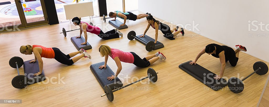 Group of athletes performing sit-ups stock photo