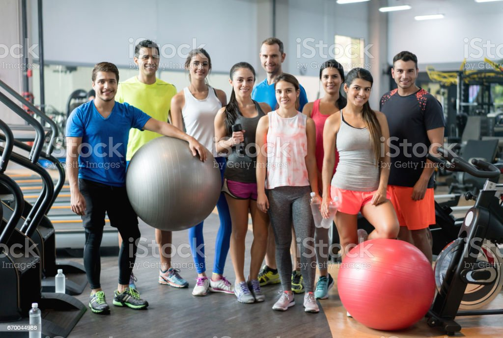 Group of athletic people at the gym stock photo