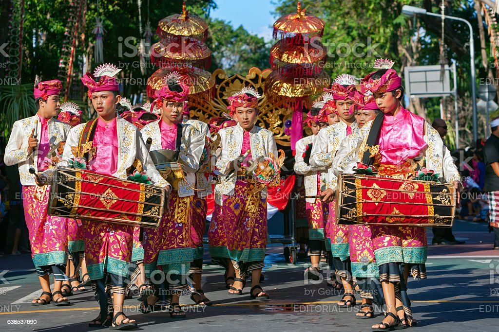 Group of Balinese men in traditional costumes play gamelan music stock photo