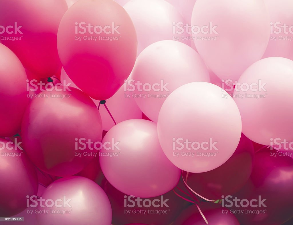 Group of balloons in various shades of pink stock photo