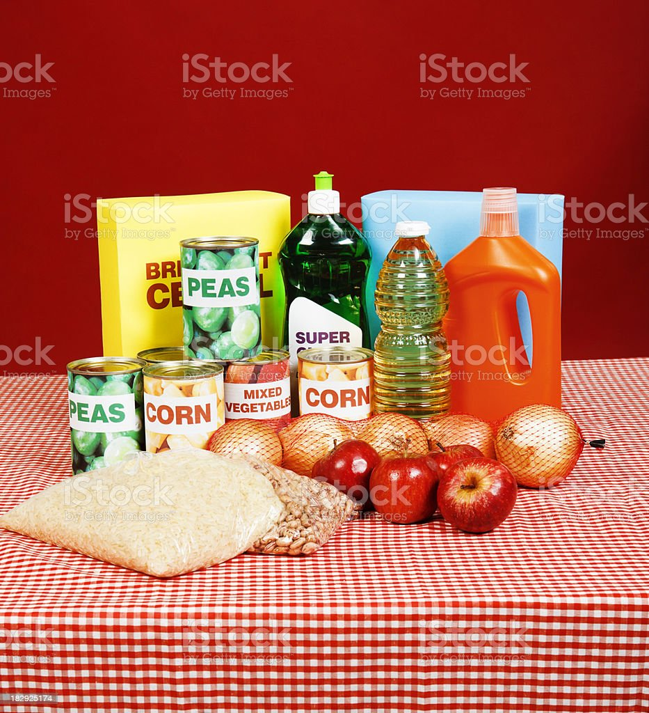 Group of basic foods and cleaning products on tablecloth royalty-free stock photo