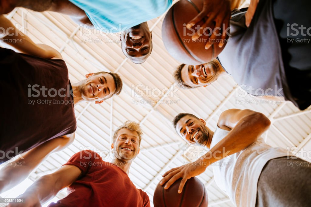 Group of basketball player looking at the camera stock photo