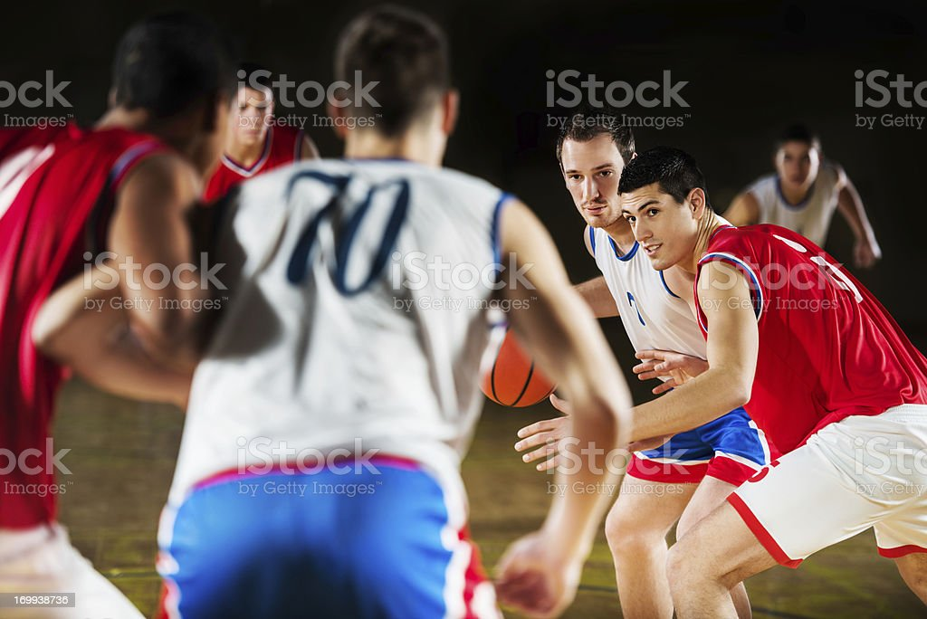 Group of basketball players in action. royalty-free stock photo