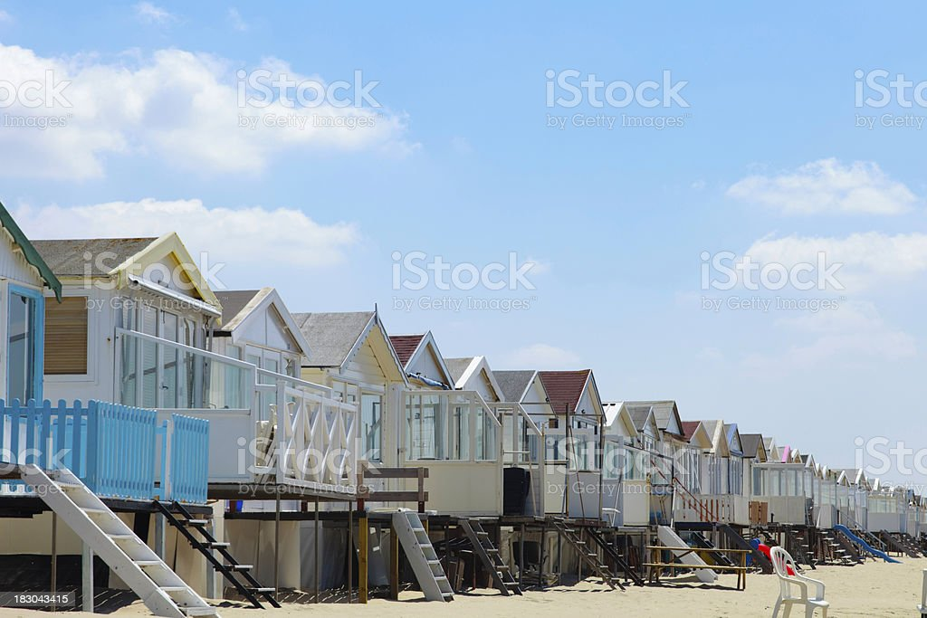 group of beach houses in a row stock photo