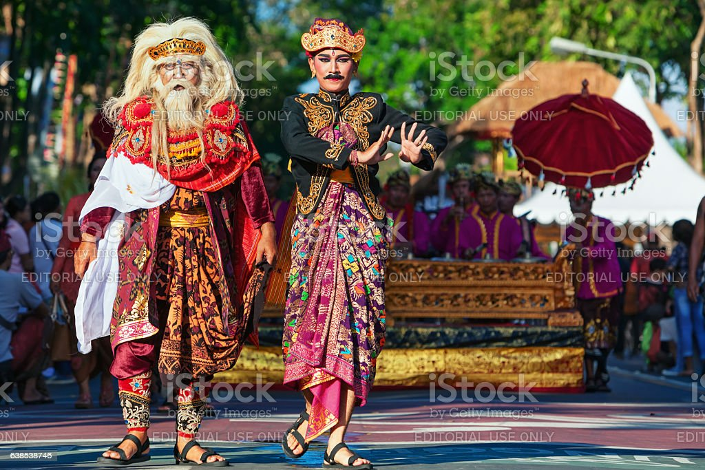 Group of beautiful Balinese men dancers in traditional costumes stock photo