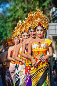 Group of beautiful Balinese women dancers in traditional costumes