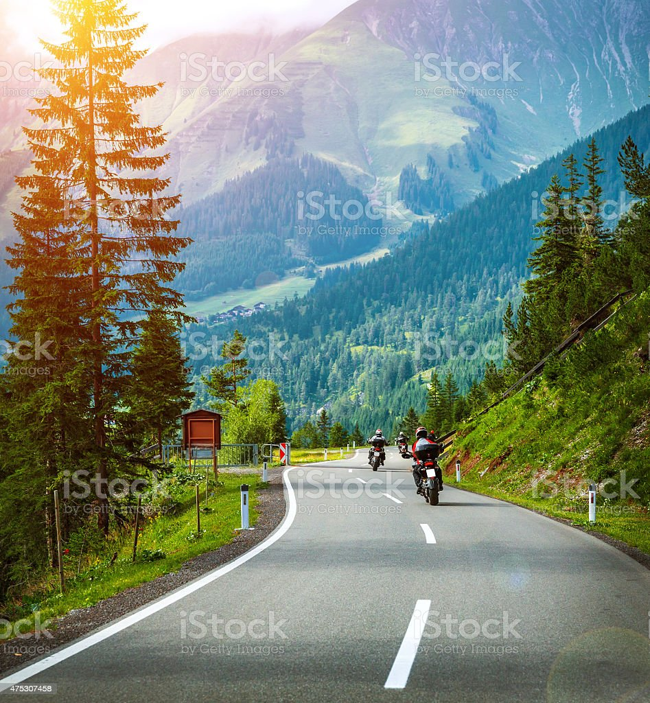 Group of bikers in Alps stock photo