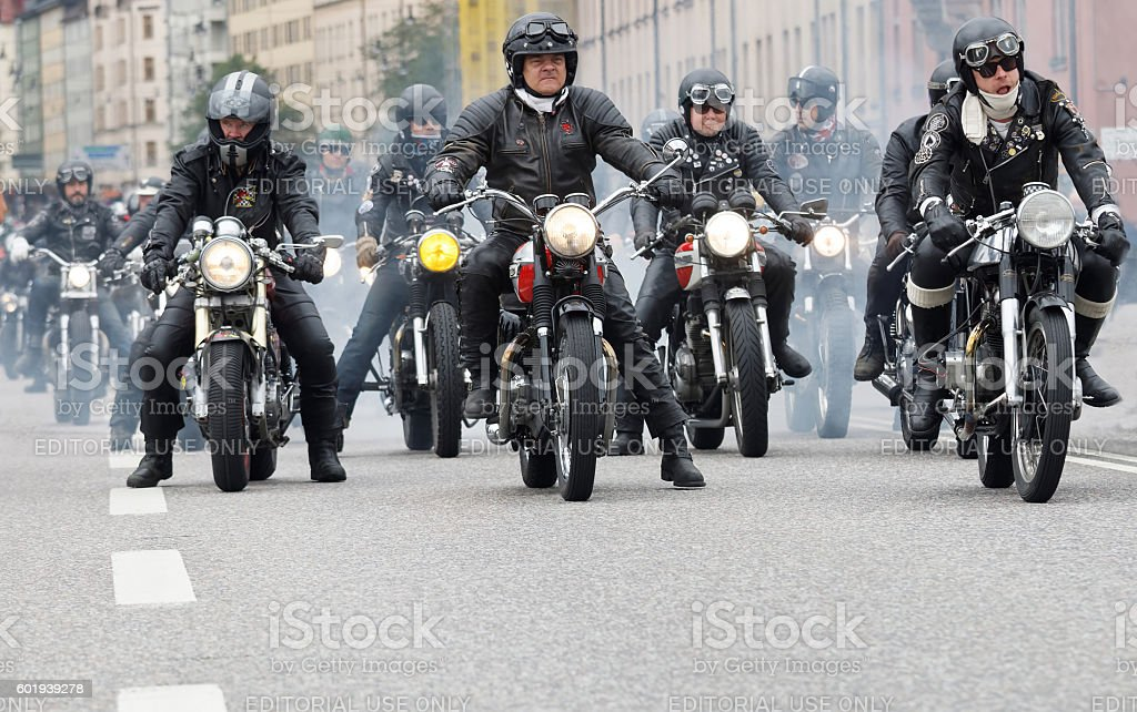 Group of bikers on old fashioned motorcycles stock photo