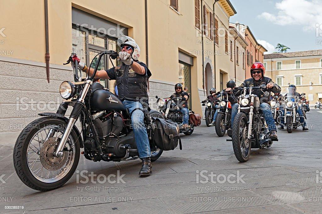 group of bikers riding Harley Davidson stock photo