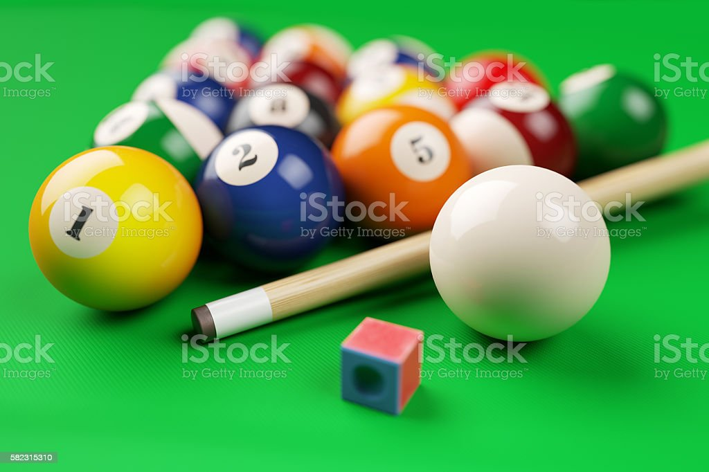 Group of billiard colored balls, cue and chalk stock photo