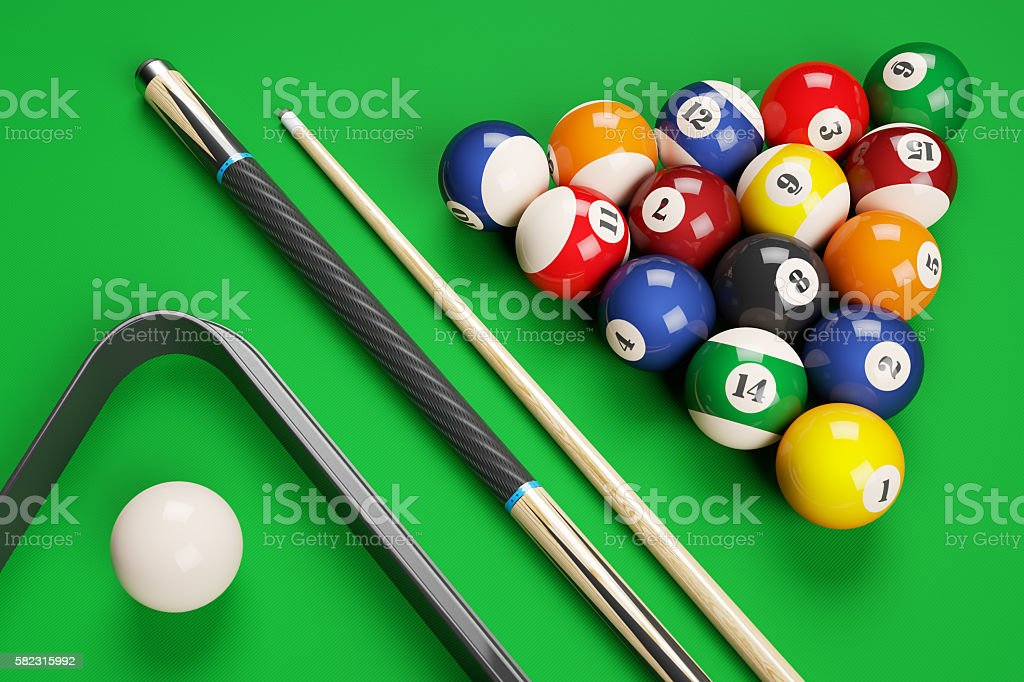 Group of billiard colored balls, cues and triangle stock photo