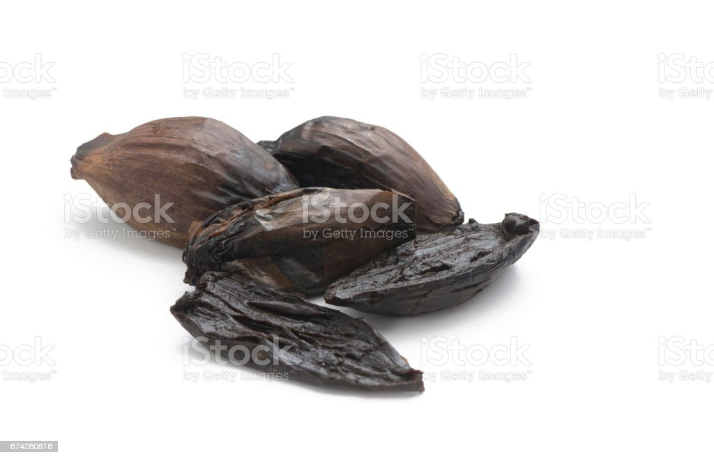 group of black organic fermented onions stock photo