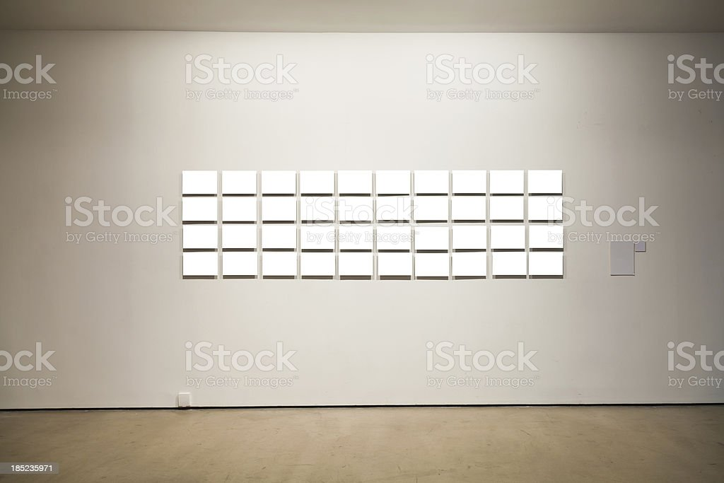 Group of blank frames on the wall at art gallery stock photo