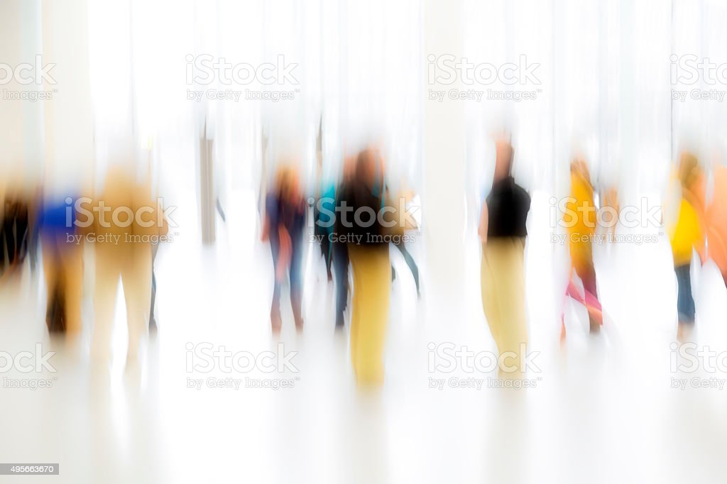 Group of Blurred People In Bright Lobby, Blurred Motion stock photo