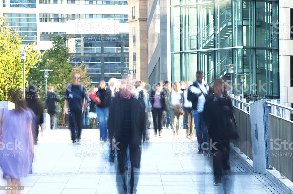 Group of Blurred People Walking in a Financial District royalty-free stock photo