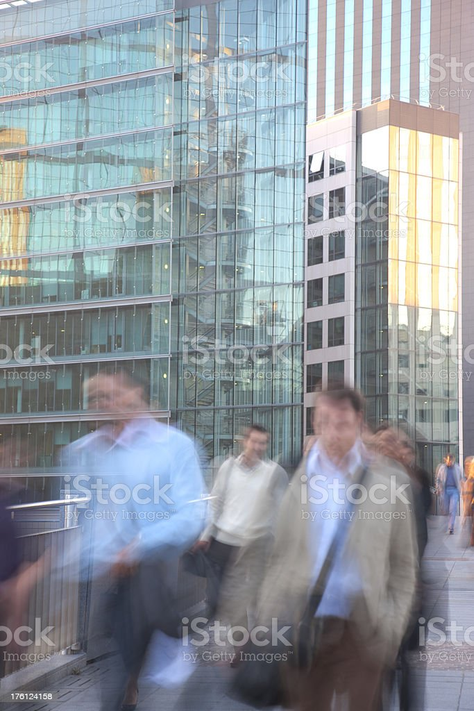 Group of blurred young businessman walking in a financial district royalty-free stock photo