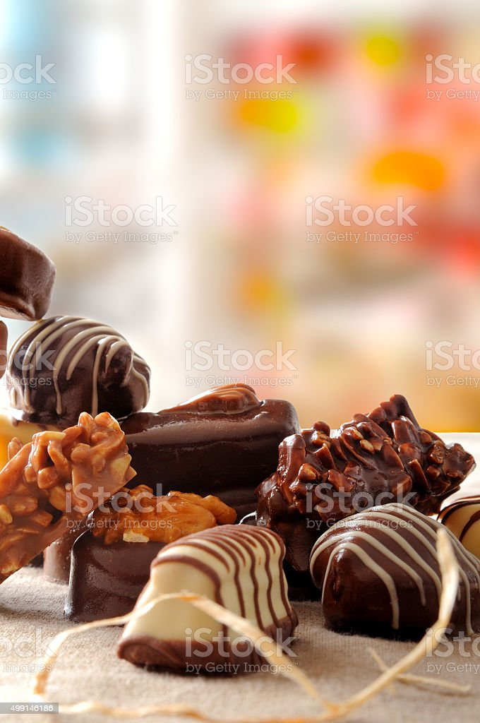 Group of bonbons stacked on tablecloth fabric closeup vertical c stock photo