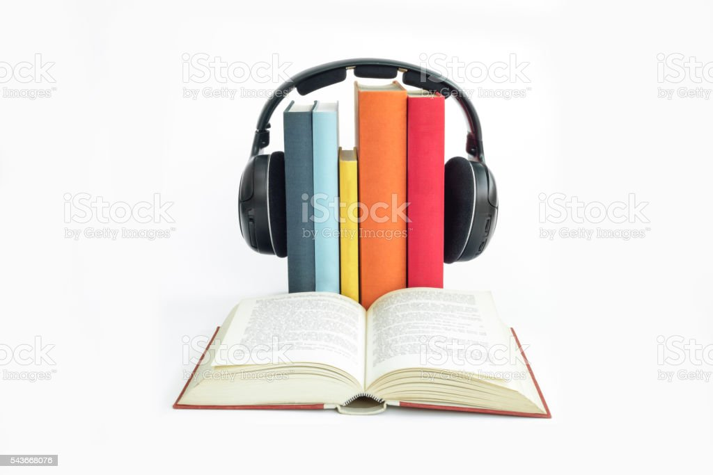 Group of books and headphones related to audiobooks with isolate stock photo