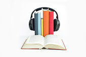 Group of books and headphones related to audiobooks with isolate