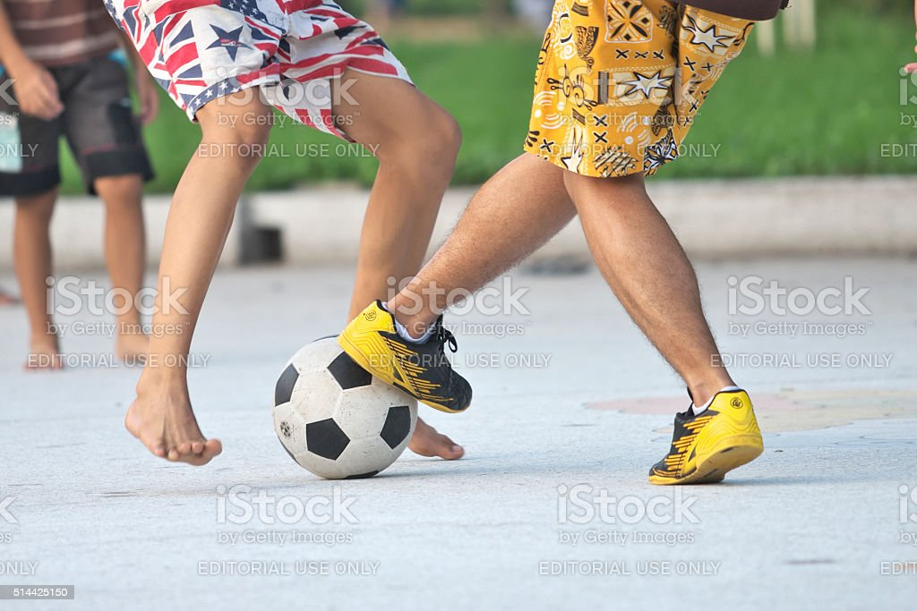 Group of boy practicing football stock photo