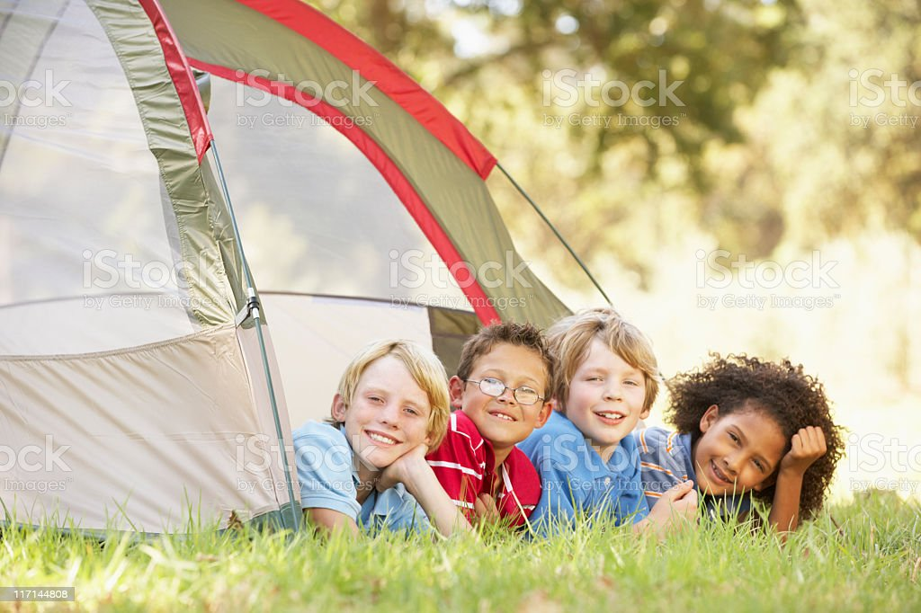 Group Of Boys Having Fun In Tent royalty-free stock photo