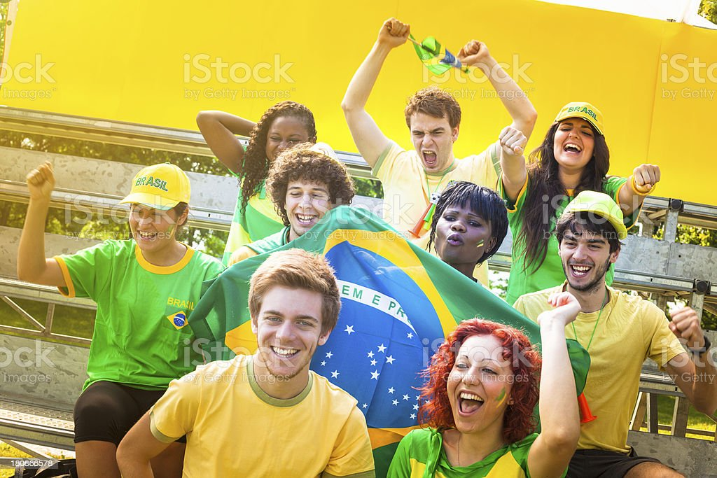 Group of Brasilian Footbal Team Supporters Cheering royalty-free stock photo