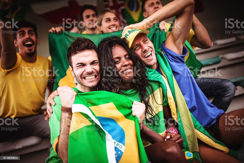 Group of brazilian supporters at stadium stock photo
