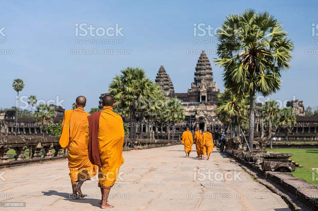 Group of Buddhist monks walking in Angkor Wat in Cambodia stock photo