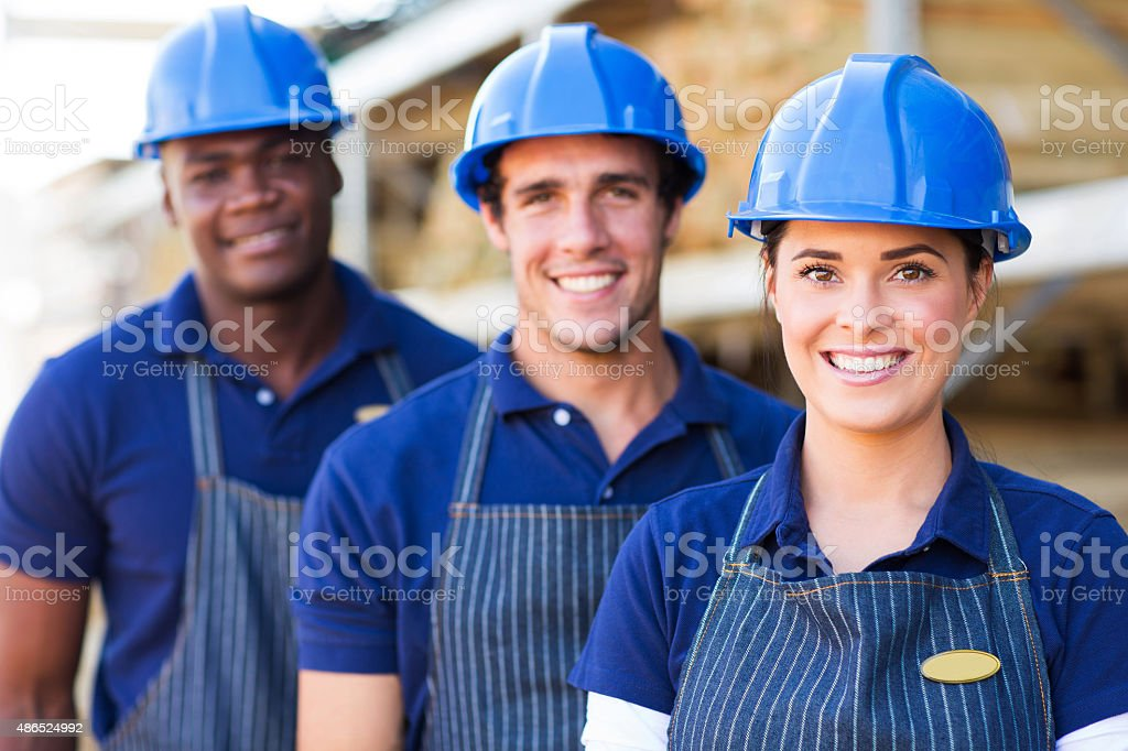 group of building material warehouse workers stock photo